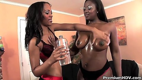Ebony lesbian girls applying oil all over their boobies Nevaeh Keyz and Aryana Starr