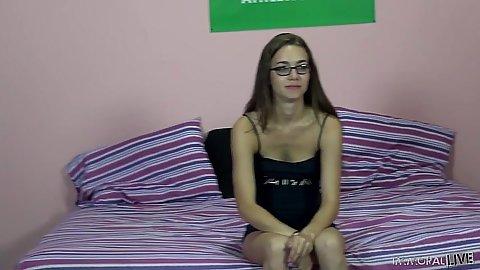 Skinny  girl Tali Dova in glasses doing fellatio