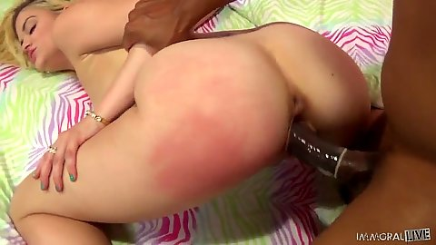 Adorable blonde Dallas enjoys a large black cock from behind