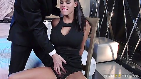 Brunette Peta Jensen hands tied behind her back