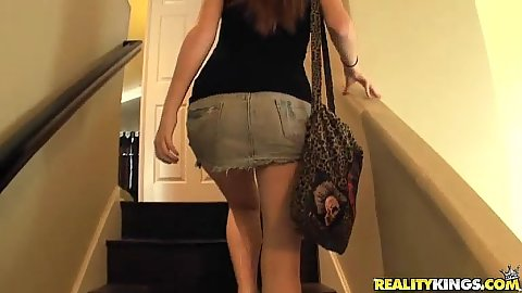Kassondra Raine picked up and walks up a flight of stairs in her miniskirt