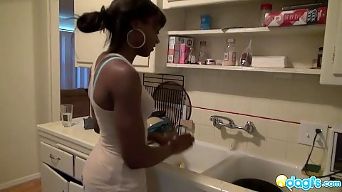 Ebony amateur Anna Foxx doing something in the kitchen then stripping