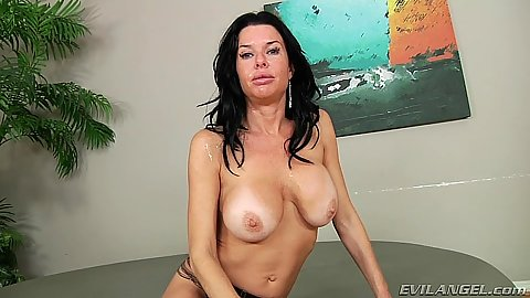 Posing topless with milf Veronica Avluv in porn star behind the scenes