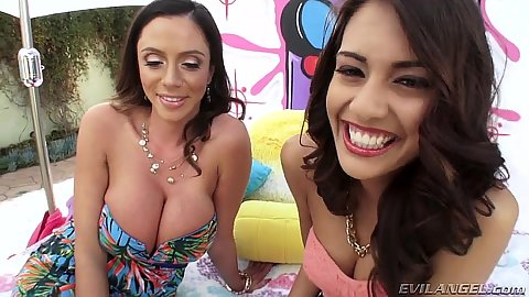 Smiling fully clothed busty latina whore Janice Griffith and Ariella Ferrera