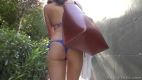 Chanel Preston getting ready to go somewhere in her bikini