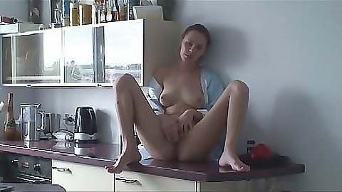 Fingering herself on the lonely kitchen counter