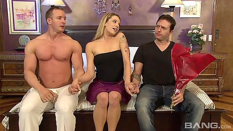 Teasing Dahlia Sky jerks two mans cocks in threesome