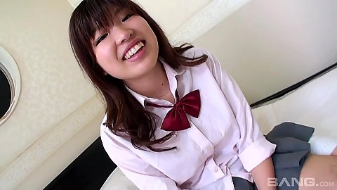 18 year old school girl Ai Okada smiling and placing penis in mouth