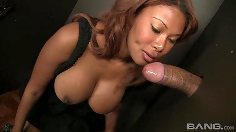 Ebony Jessica Dawn blowjob with exposed tits through glory hole