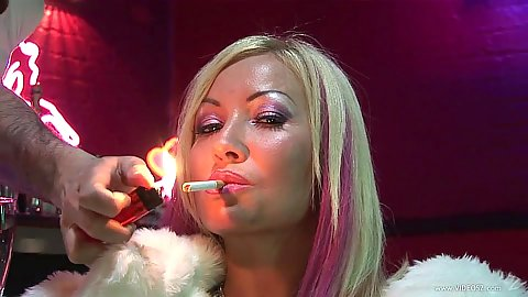 Vixen blonde Kira Croft havinga smoke then a cock in her mouth