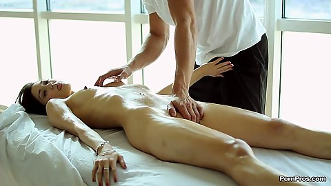 Inviting natural boobie Elana Dobrev relaxing on massage table with oil