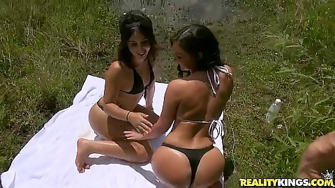 Stunning bikini latina girls Brittany Shae and Victoria Roxx oil each other up in the outdoors