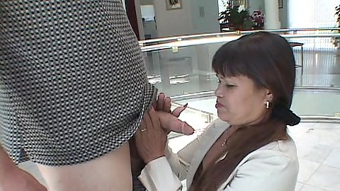 Mature asian mom giving head while clothed