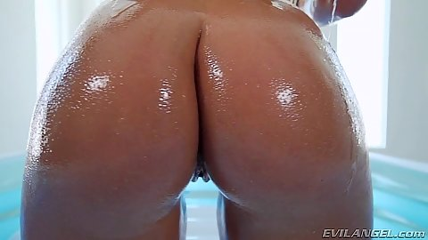 Oiled up behind Abella Danger looking very sexy and arousing