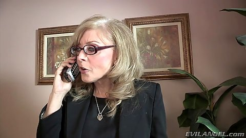 Appearing office mature Nina Hartley talks on the phone with stepson