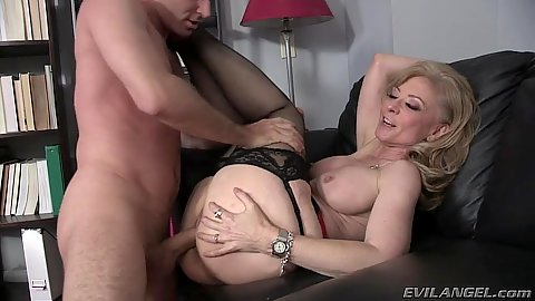 Mature Nina Hartley has sex and her evil stepson is in the office