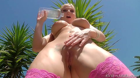 Sexy big boobs stockings milf outdoors pouring liquids on body Christie Stevens