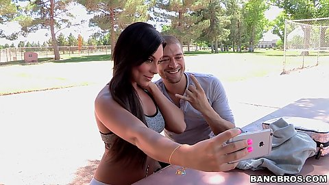 outdoor babe Gianna Nicole and dude taking selfie in public park