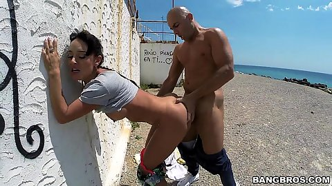 Hairy Franceska Jaimes doing outdoor standing fuck up a wall on public beach