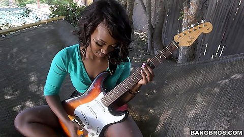 Playing some music and undressing with innocent looking black teenie Skyler Nicole