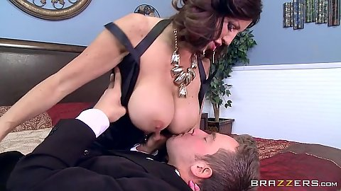 Busty wife Tara Holiday teases mens nose with her nipples