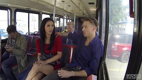 Karmen Bella is talking to a guy on a public bus and he fingers her