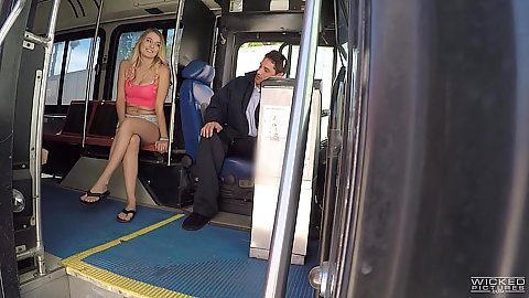 Blonde fully clothed Natalia Starr approaches a public bus driver and gives him head