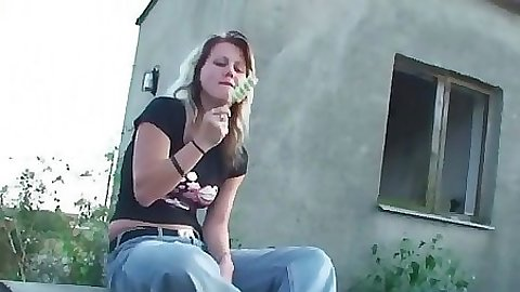 Sexy gf sitting by a farm house in her tight jeans