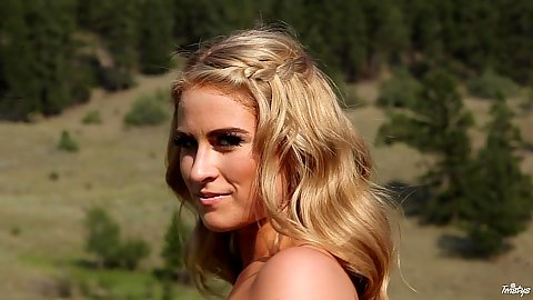 Solid blonde Maya Rae is a naked babe in nature