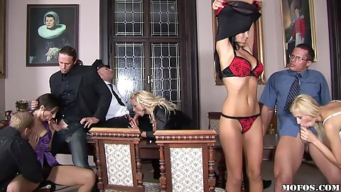 Two sexy babes are sucking guys off in court
