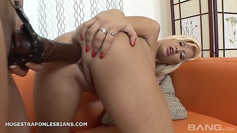 Lesbians trying to fuck some very large sex toys in their ass