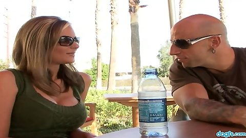 Fully clothed milf Phoenix outdoors at the table