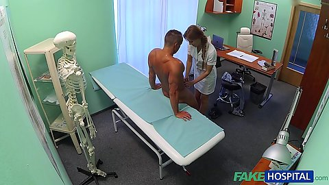 Doctor office with nurse going down to suck male patient