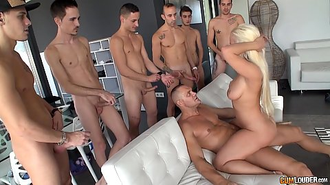Blonde sits on dick Blondie Fesser with other men just jerking off with dp in the middle