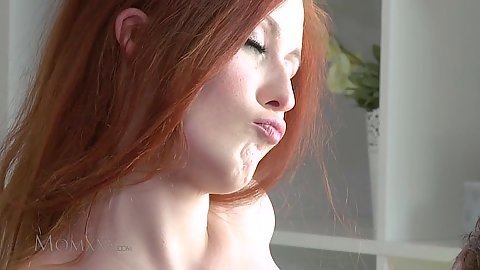 Pleasing redhead milf Isabella lays on bed