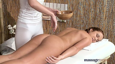 Charlotta and Angella spreading oil on back for massage