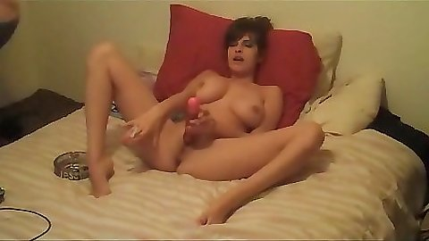 Sexy busty gf lays with legs open on the bed pillow