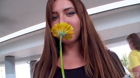 Ally Breelsen looking pretty while smelling flower on public parking lot