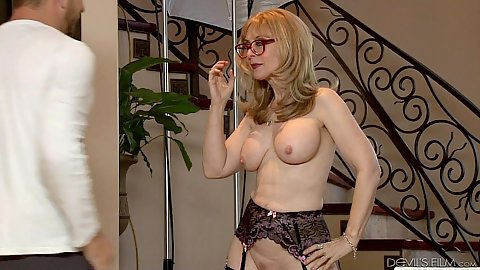 Big boobs milf in lingerie walking around in behind the scenes