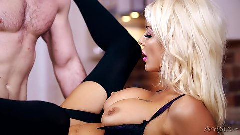 Enticing blonde milf spreads her legs nice and wide Tia Layne