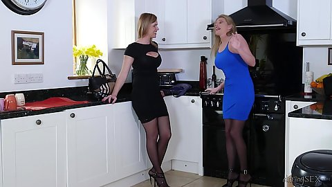 Elegant fully dressed milf Holly Kiss