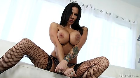 Frisky big boobs Lylith LaVey in her fishnets with a butt plug up her ass