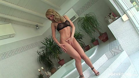 enticing euro solo chick squatting on stairs to feel herself up