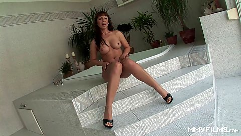 Solo high heels milf getting very alluring in the bathroom Maria Bellucci
