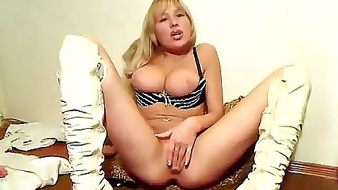Teen in this sexy white boots playing with a vibrator