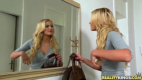 Aisha getting ready in front of the mirror