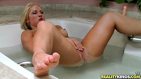 Muscular blonde slut Lorena Fire touches herself in shower and gives head