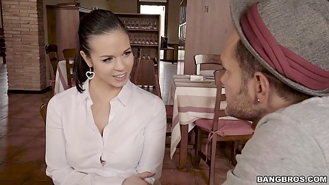 Smiling fully clothed waitress Nekane jerks off client