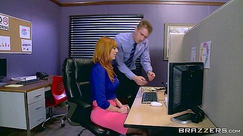 Redhead office telemarketer Lauren Phillips doing her work