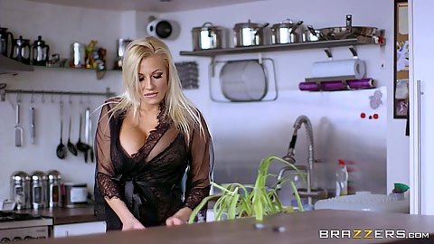 Blonde babe milf Michelle Thorne cooking something in the kitchen